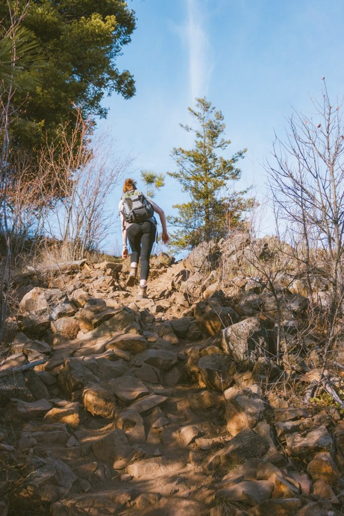 Girl hiking the Spion Kop trails in Lake Country