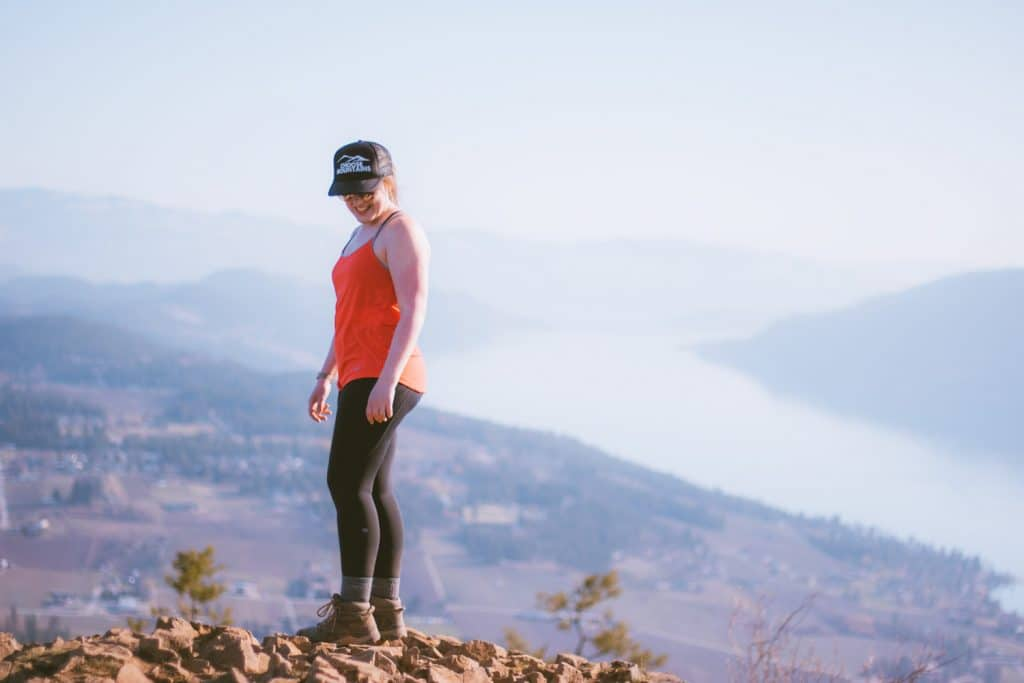 Girl at the summit of Spion Kop with Lake Country in the background