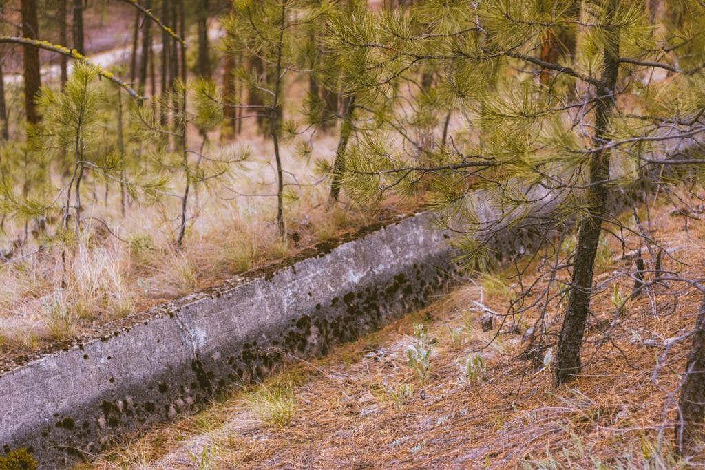 A close up of an old irrigation channel on the Quail Flume Trail