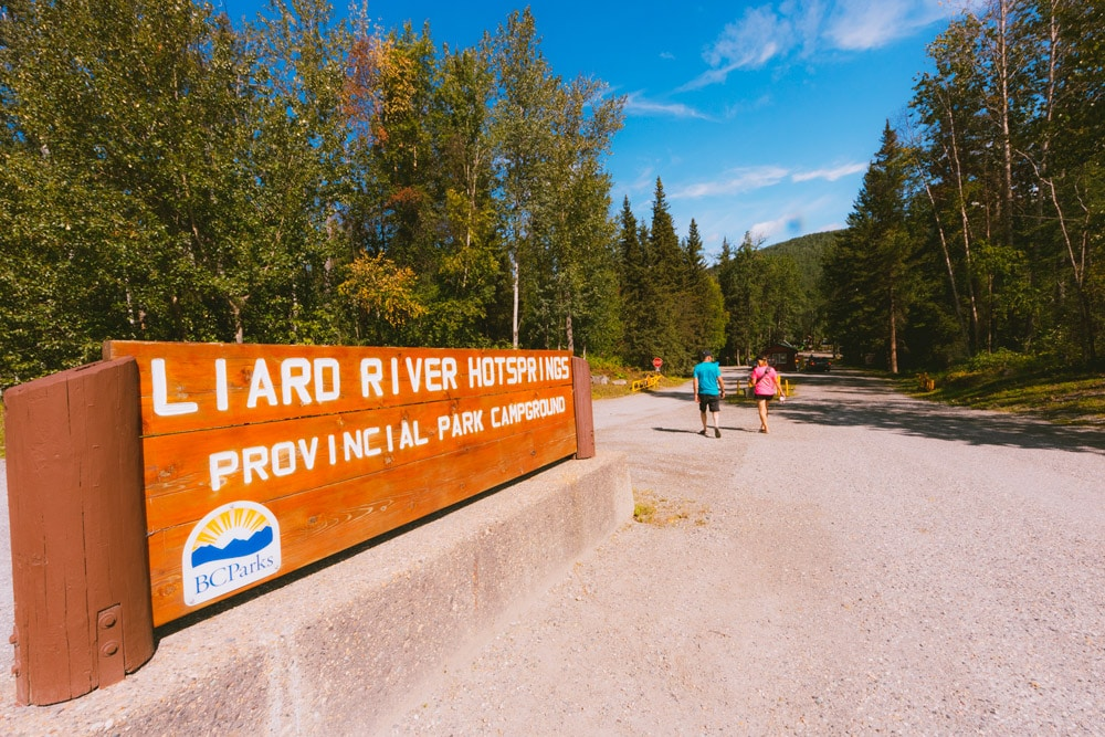 Sign and gate house at the entrance to the Liard River Hot Springs campground.