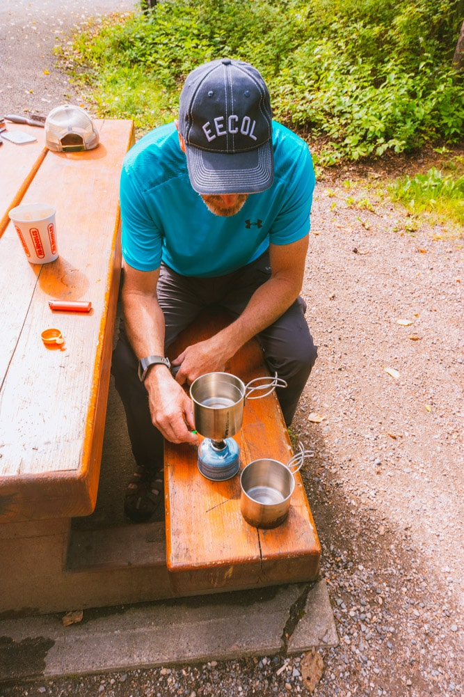 Cooking dinner on a portable stove at Liard Hot Springs Provincial Park in Northern BC