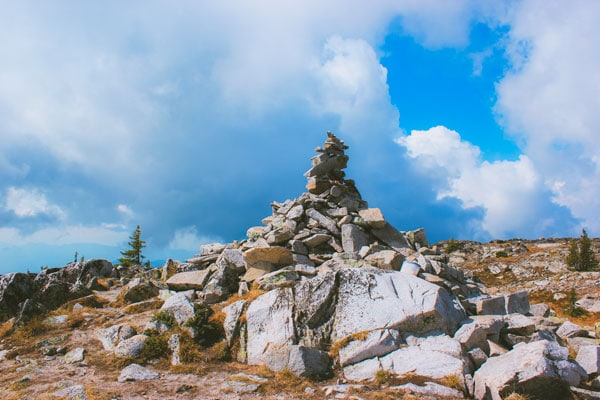 Large rock cairn at the summit of the Peak Trail at Big White.