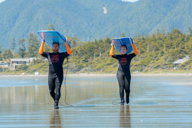 Carrying surf boards in Tofino