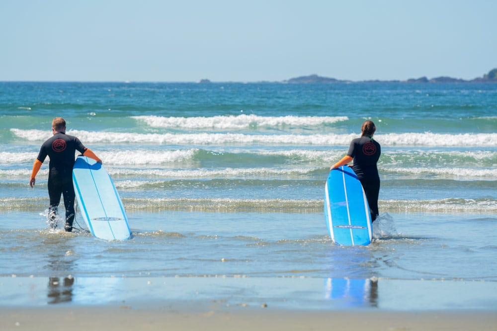 Sam and Jacob from Explore the Map learn to surf in BC