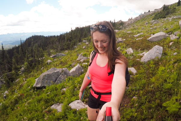 Woman hikes through a rocky field on the Rhonda Lake Trail