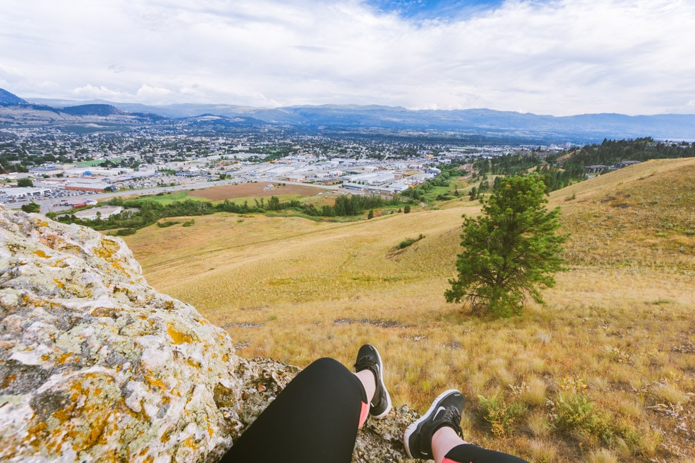 Feet on a rock with a view of Rutland from Mt Baldy