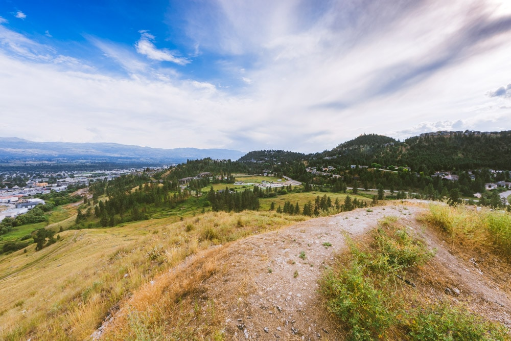 The gravel trail at the summit of Mt Baldy with a view over Dilworth Mountain