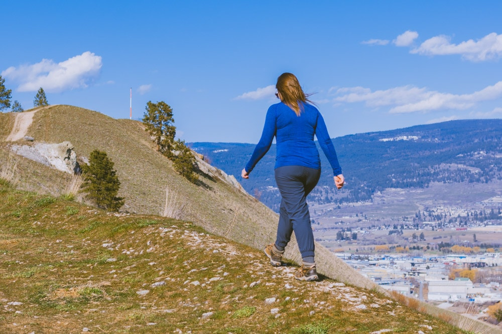 Woman walks along the top of Mt Baldy with the summit in the background