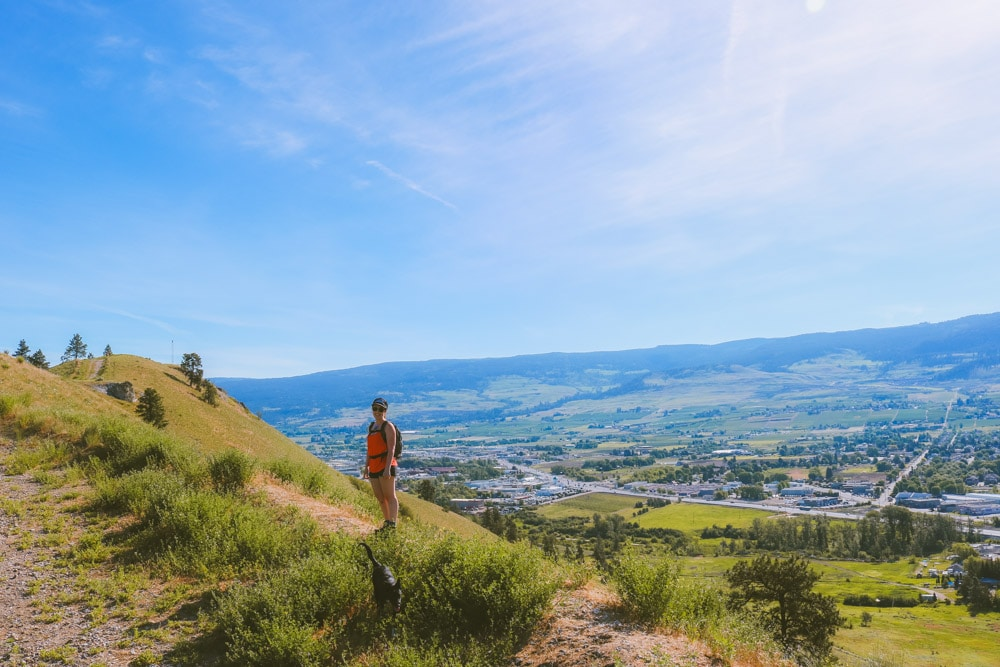 Woman standing at the top of Mt Baldy with a view over Rutland