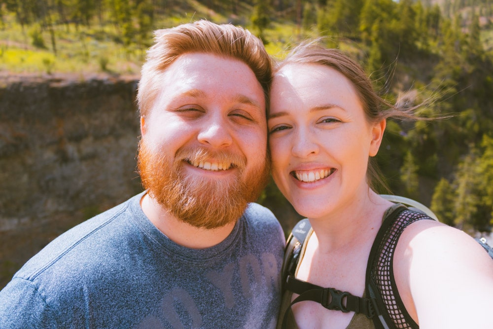 Selfie of a couple while hiking.