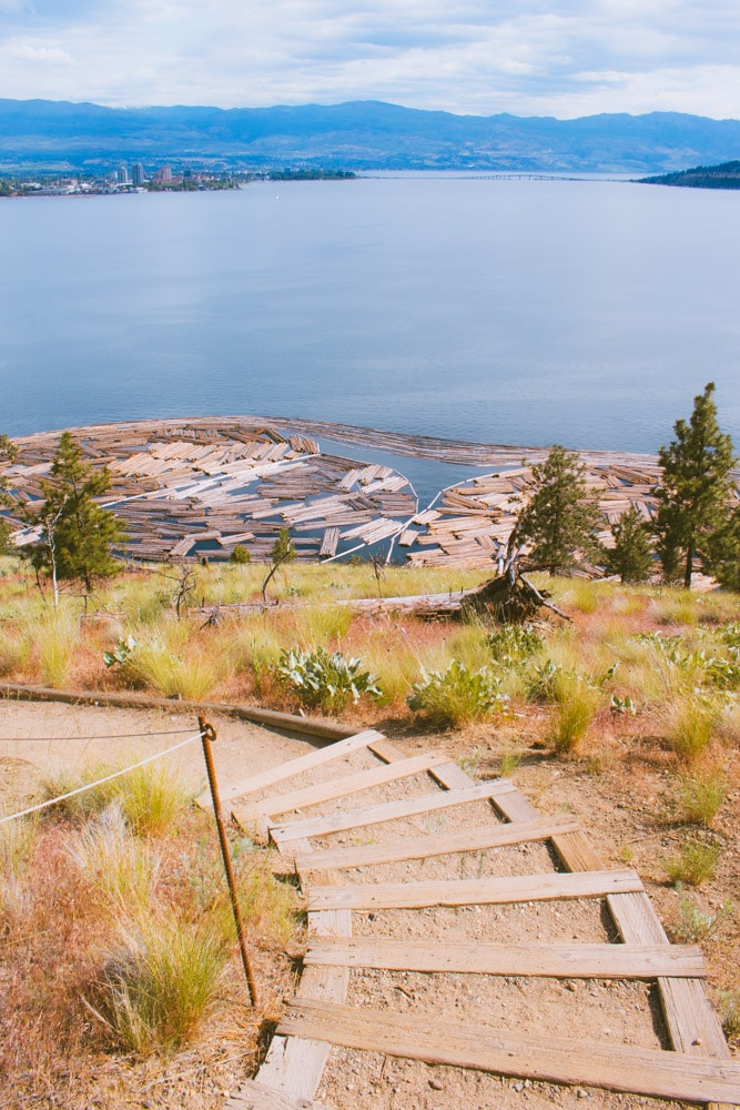Staircase on Canyon Rim Trail with views of Okanagan Lake and the mill's log booms