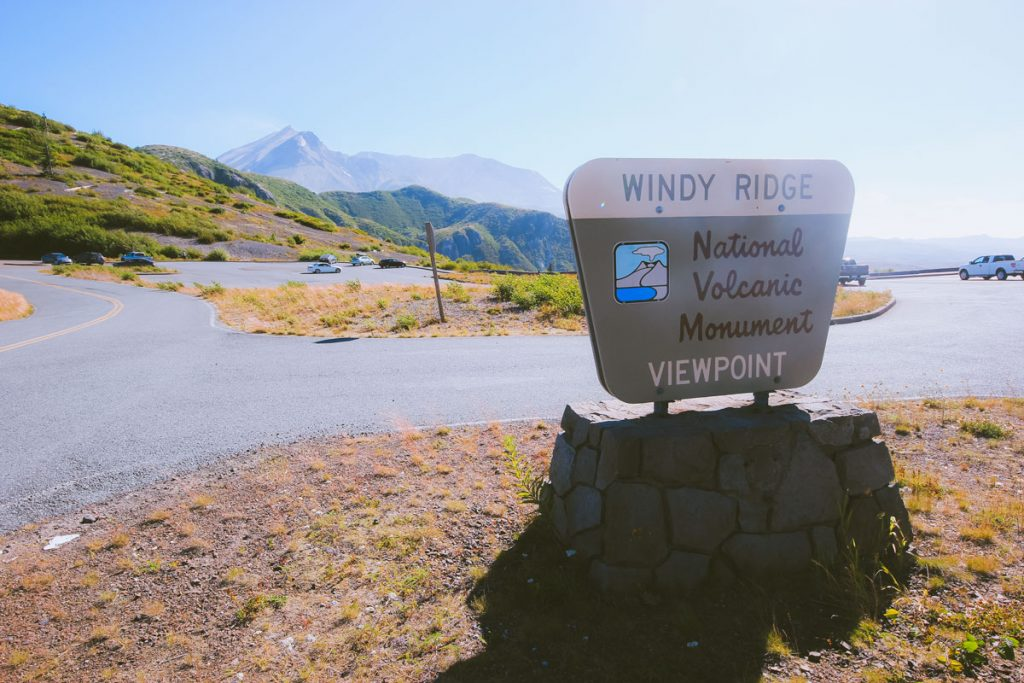 The Windy Ridge Viewpoint sign at the parking lot with Mt St Helens in the background.