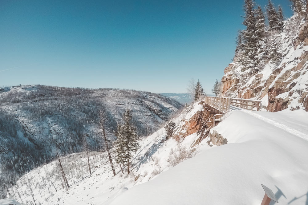 Snowy trail while snowshoeing at Myra Canyon Trestles on the KVR in Kelowna