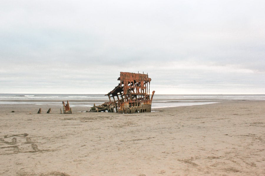 The Peter Iredale shipwreck sits abandoned on Clatsop Beach at Fort Stevens State Park, Oregon.
