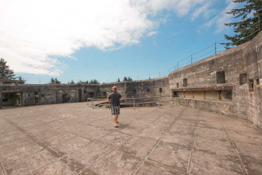 Jacob from Explore the Map explores the old gun pit at Battery Russell at Fort Steven State Park, Oregon.