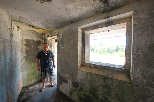 Jacob from Explore the Map explores the lower floors at Battery Russell at Fort Stevens, Oregon.