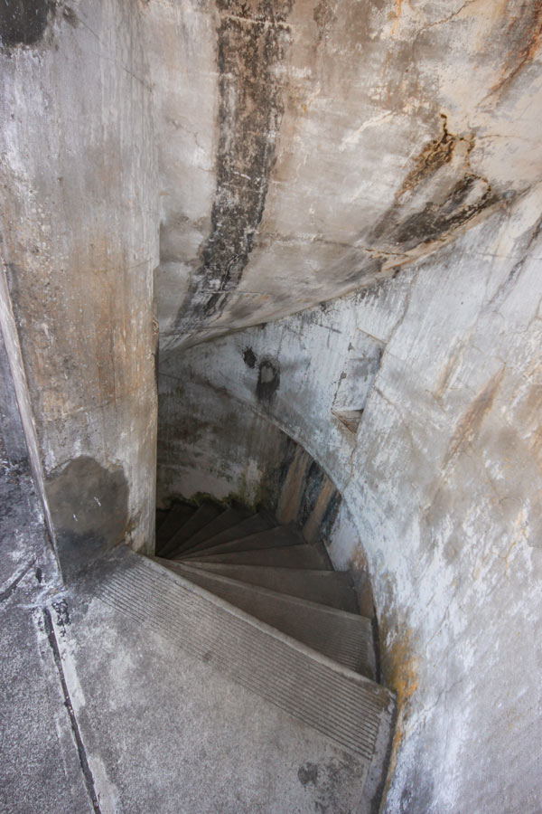 A spiral staircase leading to the lower level of this battery.