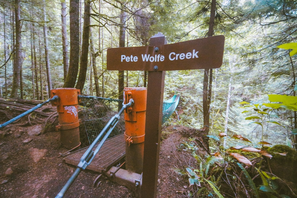 Pete Wolfe Creek sign at the beginning of the suspension bridge