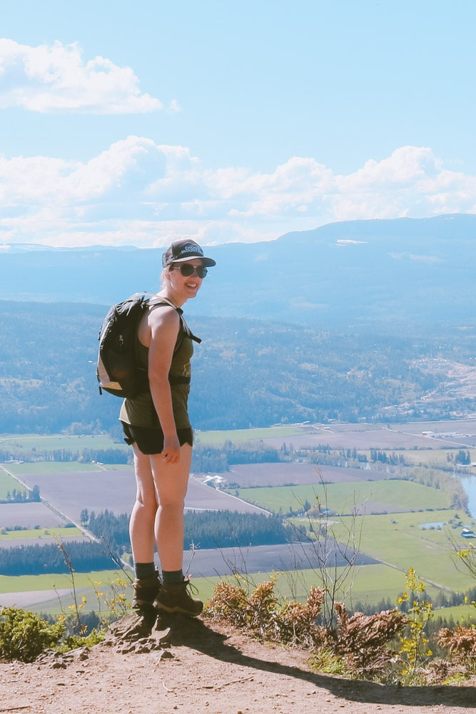 Woman enjoys a break at the Larch Hills lookout on the Enderby Cliffs trail