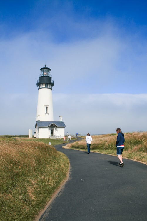 Walking towards Yaquina Head Lighthouse on a twisty path.