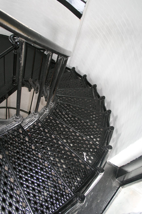 Looking down the metal spiral staircase in the tower of Yaquina Head Lighthouse