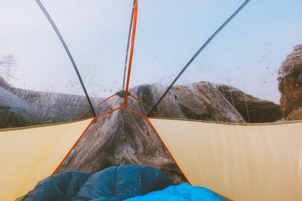 View from inside the tent. Water is stuck to the edges.