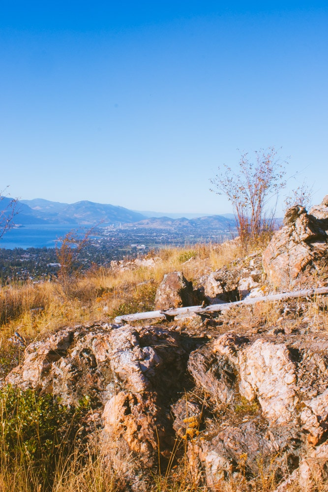 A rocky outcropping at Kuipers Peak with Okanagan Lake in the distance.