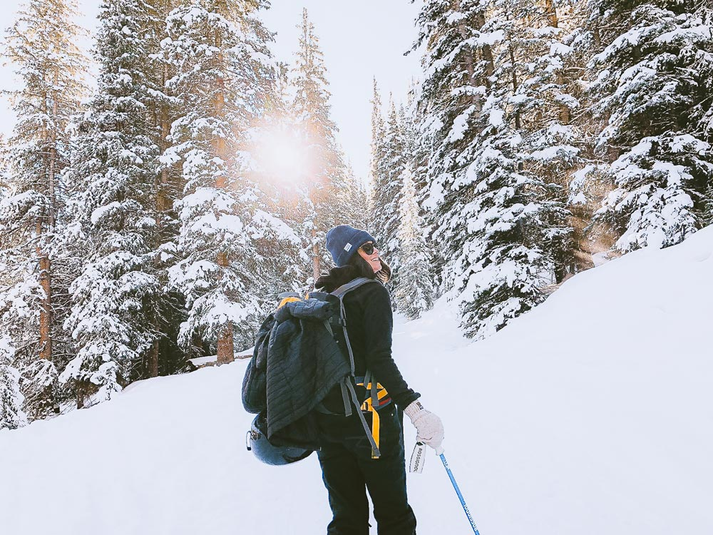 Woman snowshoeing on a trail in the Okanagan in the winter.