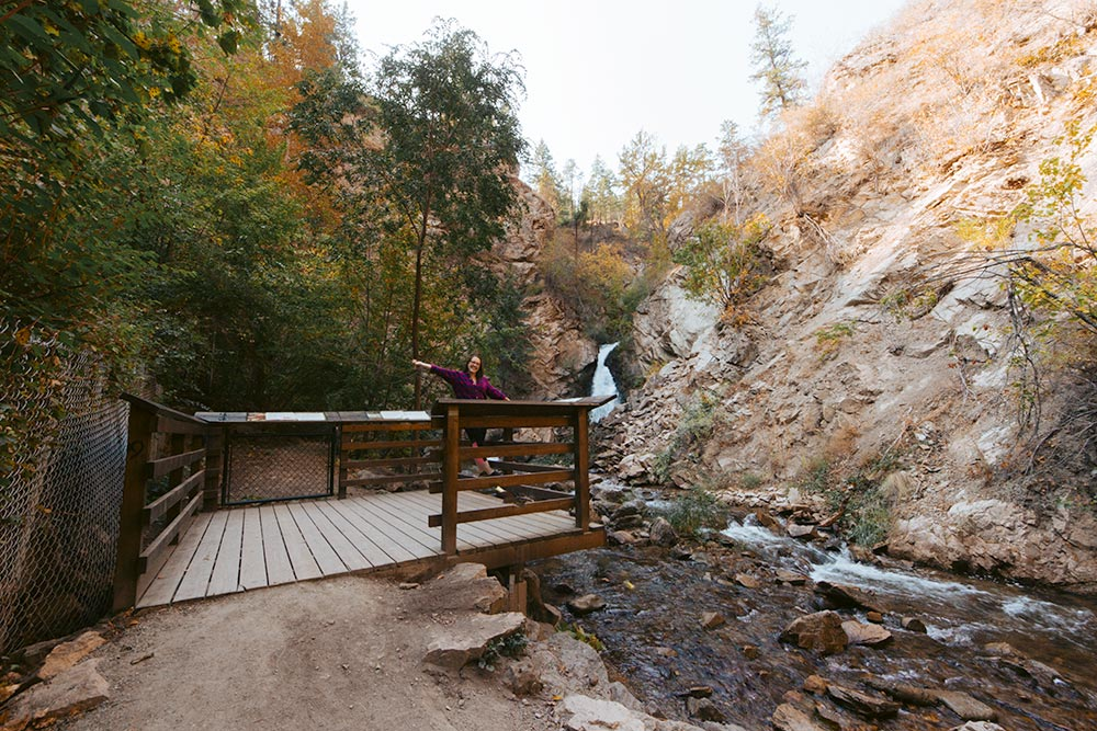 Woman stands at the viewing platform at Hardy Falls