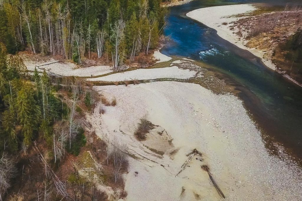 An aerial view of Kinbasket Beach, the Shuswap River, and Cooke Creek at the Kingfisher Interpretive Centre