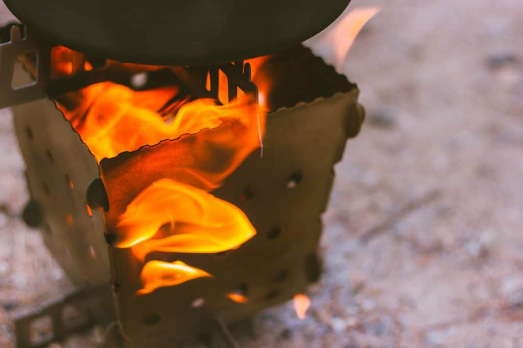 Close up of the Siege Stove with fire coming out the sides.