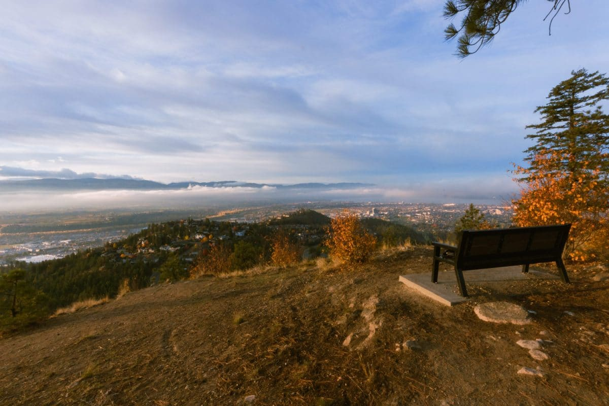 A bench at the Dilworth viewpoint overlooks Kelowna.